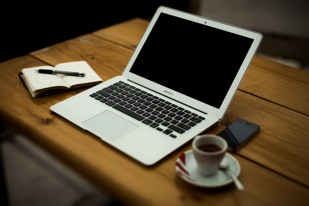 Notebook, laptop and coffee cup